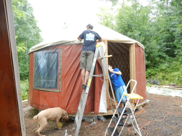 With a little help from friends, the walls got up just in time for a rainstorm and for us to head back to MN to move.