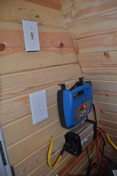 The generator vs. inverter switch, a light switch, the blue battery charger, and the inverter.